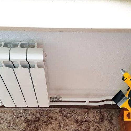 Установка радиатора отопления на кухне